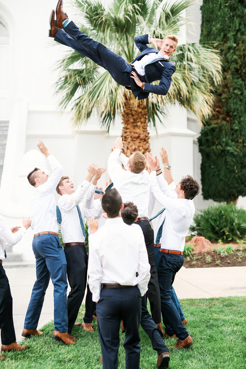 groom thrown in the air, holmstead ranch wedding, lds temple wedding, st george wedding, st george wedding photographer, southern utah wedding, photographer